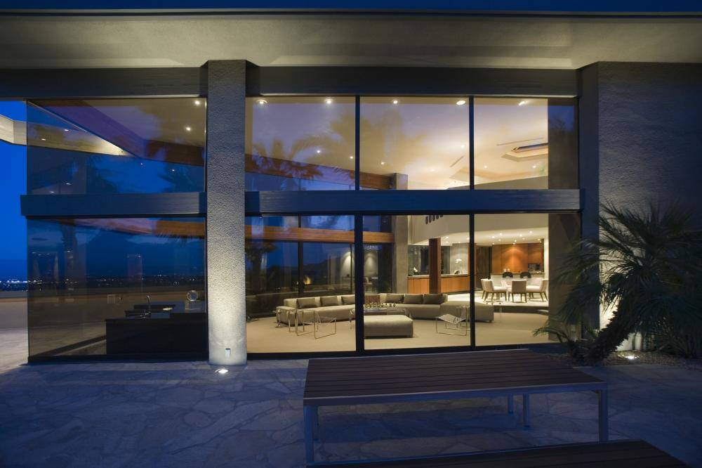 A luxury home with glass windows