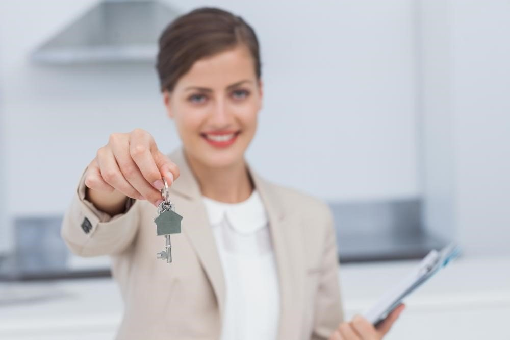 A lady giving a house key