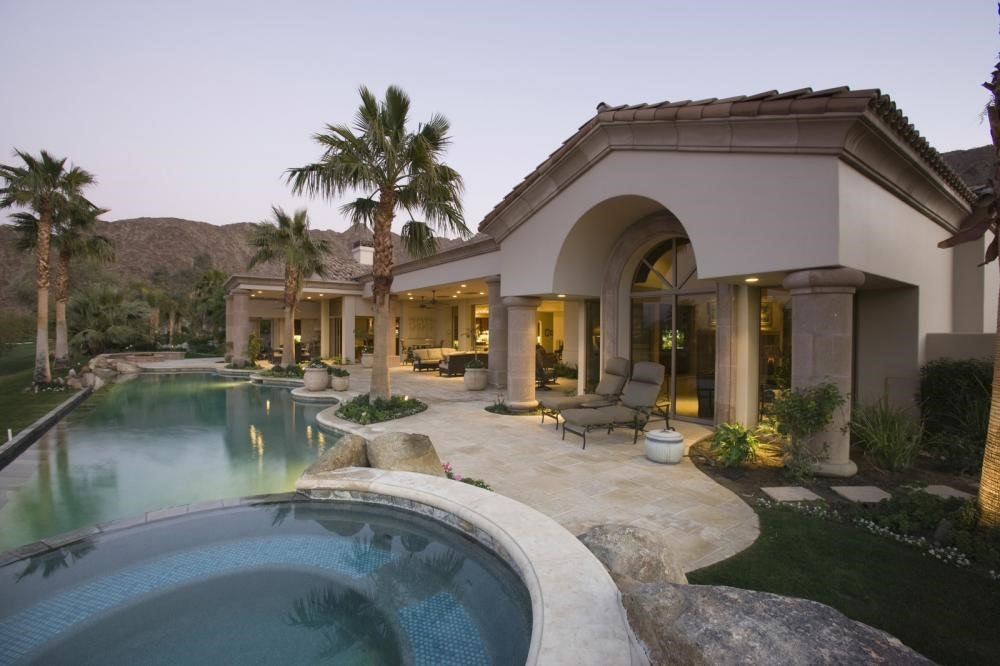 pool and a luxury house